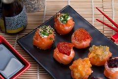 Sashimi and sushi rolls. Japanese food background close diner Stock Photos