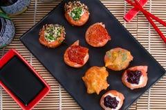 Sashimi and sushi rolls. Japanese food background close diner Stock Photography