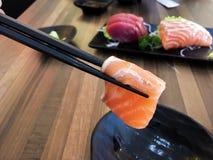 Sashimi. Sushi salmon fish dish japan rice food wood chopsticks background Royalty Free Stock Image