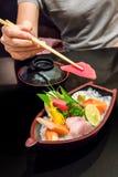 Sashimi sushi set. With chopsticks and soup royalty free stock photography