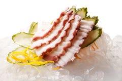 Sashimi tradicional del sushi en un fondo blanco Foto de archivo libre de regalías