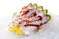 Sashimi tradicional del sushi en un fondo blanco Foto de archivo