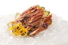 Sashimi tradicional do sushi em um fundo branco Fotografia de Stock Royalty Free