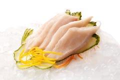 Sashimi tradicional do sushi em um fundo branco Fotos de Stock Royalty Free