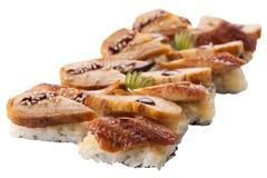 Sashimi tradicional do sushi em um fundo branco Imagens de Stock