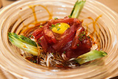 Sashimi tuna with Quail egg. Japanese traditonal food in the decorated container Royalty Free Stock Image