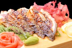 Sashimi unagi on a board closeup Stock Photos
