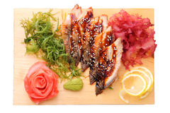 Sashimi unagi on a board top view Stock Photos