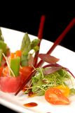 Sashimi on a white plate with chop sticks. Freshly made japanese sashimi with a micro green salad stock photos