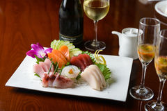 Sashimi with White Wine Royalty Free Stock Images