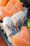 Sashimisatz der rohen Meeresfrüchte Stockbilder