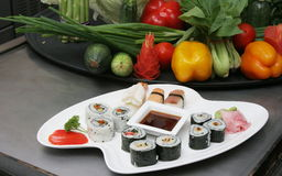SASHMI OR SUSHI. Sashimi or Sushi is a Japanese dish consisting of small balls or rolls of vinegar-flavoured cold rice served with a garnish of vegetables, egg Royalty Free Stock Photos