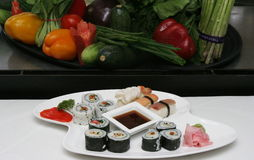 SASHMI OR SUSHI. Sashimi or Sushi is a Japanese dish consisting of small balls or rolls of vinegar-flavoured cold rice served with a garnish of vegetables, egg Royalty Free Stock Images
