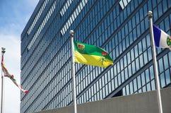 Saskatchewan flag. Flutters in the breeze outside modern building Stock Photos