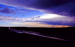 Praire Road Saskatchewan Canada. Country road under a passing storm on the Canadian prairies Royalty Free Stock Photos