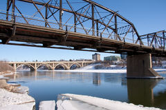 Saskatoon is the City of Bridges. A view of the Victoria Bridge and Broadway Bridge in Saskatoon, Canada on a sunny day in winter royalty free stock images