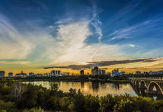 Saskatoon Skyline. The skyline of Saskatoon, Canada at sunset Stock Photo