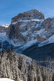 Sass Pordoi (in the Sella Group) with snow in the Italian Dolomites. The Dolomites are a mountain range located in northeastern Italy. In August 2009, the Stock Photo