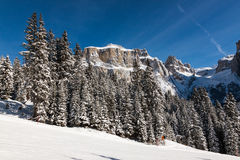 Sass Pordoi (in the Sella Group) with snow in the Italian Dolomites. The Dolomites are a mountain range located in northeastern Italy. In August 2009, the Royalty Free Stock Photos
