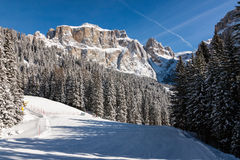Sass Pordoi (in the Sella Group) with snow in the Italian Dolomites. The Dolomites are a mountain range located in northeastern Italy. In August 2009, the Stock Images