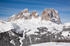 Sass Pordoi (in the Sella Group) with snow in the Italian Dolomites. The Dolomites are a mountain range located in northeastern Italy. In August 2009, the Royalty Free Stock Images