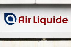 Air Liquide logo on a wall. Sassenage, France - June 24, 2017: Air Liquide logo on a wall. Air Liquide is a french multinational company which supplies royalty free stock photo