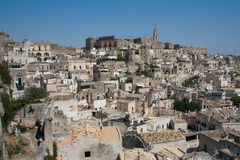 Sassi di Matera cityscape. Cityscape view of Sassi di Matera, toward sasso Barisano, during a summer sunny day Royalty Free Stock Images