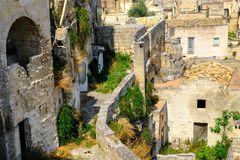 Sassi di Matera. Narrow winding street of the old cave city royalty free stock photography