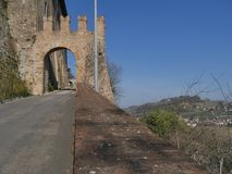 Sasso Gate in Castell`Arquato. Sasso Gate was built to allow the entrance in the old town in medieval ages stock images