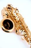 Sassofono d'ottone dell'oro isolato su bianco Immagine Stock Libera da Diritti