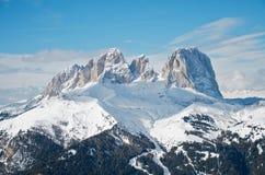 Sassolungo Dolomites. Sassolungo mountain range in the Dolomites, Italy. Blue sky Stock Image