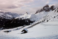 The Sassolungo Group with snow in the Italian Dolomites as seen from Passo Sella. Stock Photos