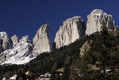 Sassolungo Langkofel Group of the Italian Dolomites in Winter from Campitello di Fassa Ski Area in Canazei. Stock Photo