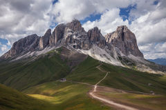 Sassolungo mountain range at cloudy day Royalty Free Stock Photography