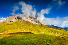 Sassolungo mountain range at sunny summer day.  Dolomites mounta Stock Photography