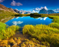 Sassolungo mountain range at sunny summer day. Dolomites mountai Royalty Free Stock Images