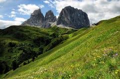 Sassolungo & Sassopiatto mountain ranges as seen from Passo Sella on a cloudy afternoon, Dolomites, Trentino, Alto Adige. Italy royalty free stock photography