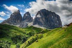 Sassolungo & Sassopiatto mountain ranges as seen from Passo Sella on a cloudy afternoon, Dolomites, Trentino, Alto Adige. Italy stock images
