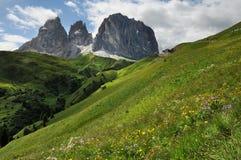 Sassolungo & Sassopiatto mountain ranges as seen from Passo Sella on a cloudy afternoon, Dolomites, Trentino, Alto Adige. Italy stock photos