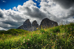 Sassolungo & Sassopiatto mountain ranges as seen from Passo Sella on a cloudy afternoon, Dolomites, Trentino, Alto Adige. Italy stock image