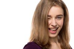 Sassy молодая женщина давая озорной wink Стоковые Фотографии RF