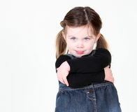 Sassy child with arms folded. On white with copyspace Royalty Free Stock Image