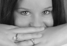 Sassy Girl. This young woman is either being coy or bashful... despite her pretty eyes Royalty Free Stock Photos