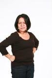 Sassy latina woman. Angry adult hispanic woman isolated on white Royalty Free Stock Images