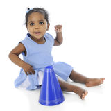 Sassy Little Cheerleader. An adorable baby cheerleader looking mighty sassy in her blue and white uniform and megaphone.  On a white background Royalty Free Stock Photo