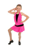 Sassy Tap Dancing Kid. A Sassy Young Tap Dancing Kid Poses in Pink Outfit Royalty Free Stock Photo