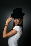 Sassy teenage girl with black top hat and big eyes Stock Photos