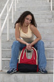 Sassy Young Latina Student with Backpack. Young Latina student with with curly hair holding a red backpack, and showing a little attitude Royalty Free Stock Image