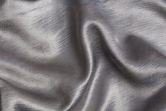 Satén de plata, un fondo Foto de archivo libre de regalías