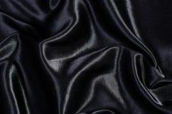 Satén de seda negro Imágenes de archivo libres de regalías